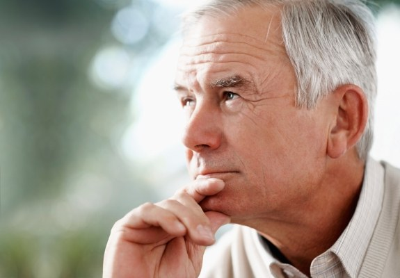 Older man consider dental implant tooth replacement